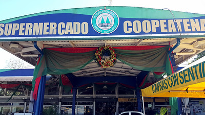 La Coope Supermarket Entrance (brightly lit at night)