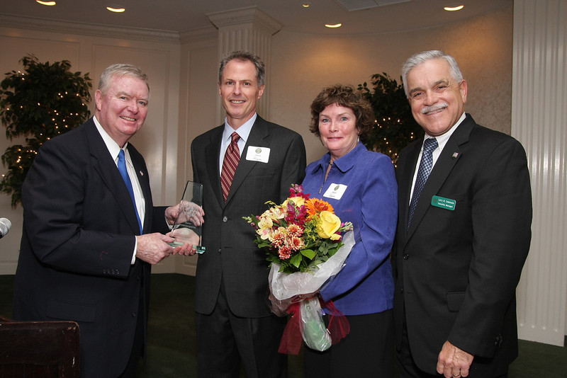 Jaquette 9160_Ed Brandt, chairman of the board of supervisors, left, presents the Lower Gwynedd Citizen of the Year Award to Jim Jacquette, joined by Joanne Jacquette and Larry Comunale, township manager.                                                                                         Bob Raines 11.17.11