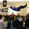Swing 7887_Teacher Joe Pisacano makes himself a human pendulum to give his fifth grade class a lesson in physics.     Bob Raines 11.15.11