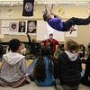 Swing 7879_Teacher Joe Pisacano makes himself a human pendulum to give his fifth grade class a lesson in physics.     Bob Raines 11.15.11