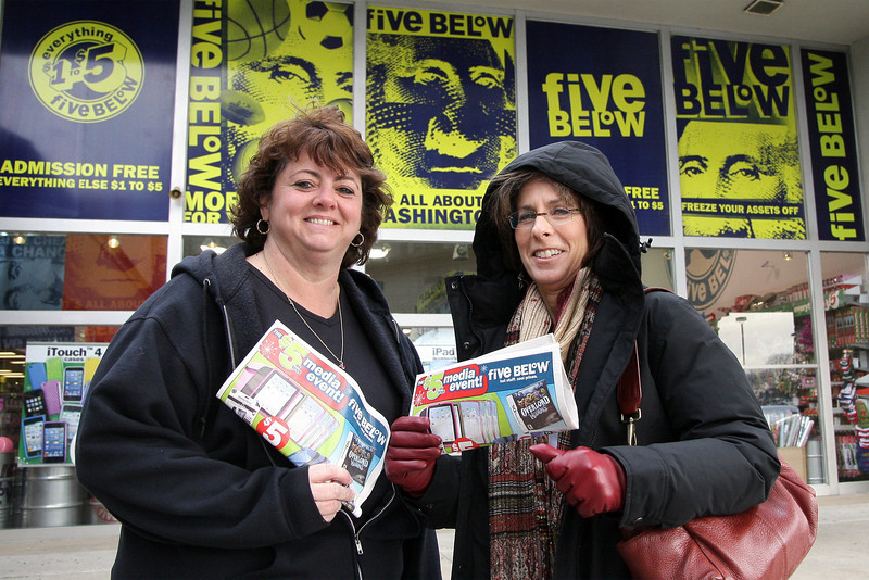 Sherri Hack, left, and Cathy Levin, members of the Plymouth Whitemarsh High School Post Prom Committee, stand in front Five Below, Plymouth Square Shopping Center, one of the stores that will allocate a percentage of their sales to the committee.<br /> Bob Raines 12/10/10