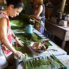 All morning people worked on cutting  and cleaning banana leaves to later  wrap our tamales in.