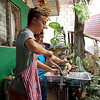 Felix, one of the twin boys from Germany hand-grinding yellow corn