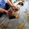 A family member shows us how to wrap the final tamale.