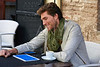 Young man with tablet pc touch in an cafe