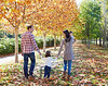 family walking in an autumn park