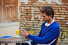 Young man with smartphone in an cafe outdoor