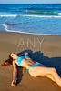 Beatifull brunette girl lying on beach sand