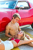 coule of teenagers in love petting in convertible