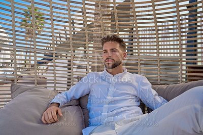 young beard man relaxed in a beach parasol