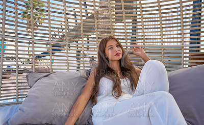 young woman relaxed in a beach hammock