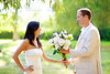couple just married with man holding flowers