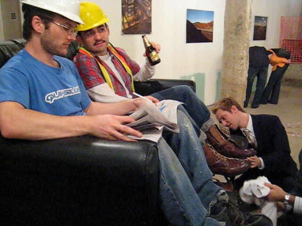 """WATCH VIDEO<br /> <br /> ShoeShine Project<br /> Performance expressing role reversal of social & economic classes. (Wall street executives shining the boots of construction workers.)<br /> 50"""" x 54"""" x 65""""h<br /> May 2008"""