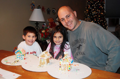A snowstorm was brewing outside & the kids were more than happy to stay in and build more gingerbread houses with their father.
