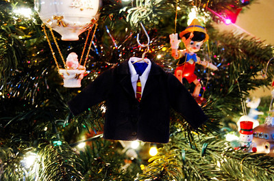 If you know Andrew, you will understand why this adorable ornament is my favorite when it comes to representing him. Clark Kent's suit jacket with a sneaky superhero shirt underneath? Classic.