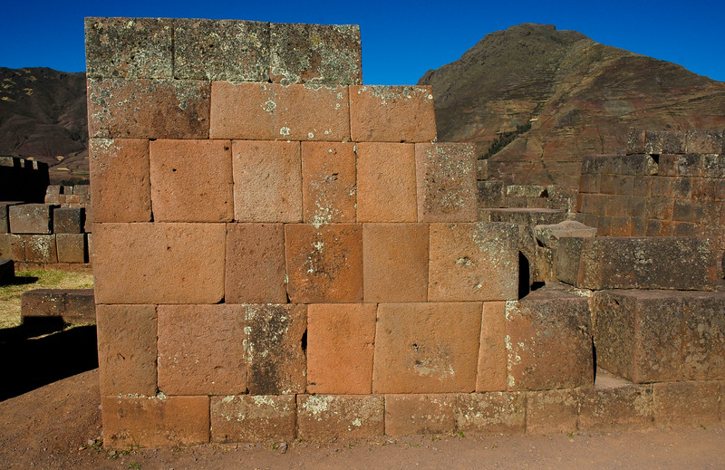 "Pisac Ruins<br /> Sacred Valley of the Incas<br /> <br /> ""The Incas were master architects, masons, and stone cutters. They were known to fit carved stones so close together that the mortar was almost invisible. Blocks of stone had to be cut, ground, and polished until the outer surfaces locked perfectly. Today, it is still uncertain how the Incas cut stone. Most buildings required vasts amounts of labor, and the Inca had no wheels, cranes, or lifting devices."""
