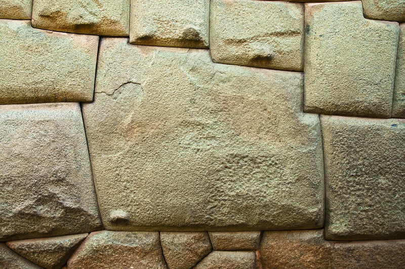 "12-Angled Stone Inca Wall <br /> Hatunrumiyoc <br /> Cuzco<br /> <br /> ""The Incas were master architects, masons, and stone cutters. They were known to fit carved stones so close together that the mortar was almost invisible. Blocks of stone had to be cut, ground, and polished until the outer surfaces locked perfectly. Today, it is still uncertain how the Incas cut stone. Most buildings required vasts amounts of labor, and the Inca had no wheels, cranes, or lifting devices."""