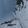 Le rappel d'accès au glacier des Périades, ambiance face nord ventée.