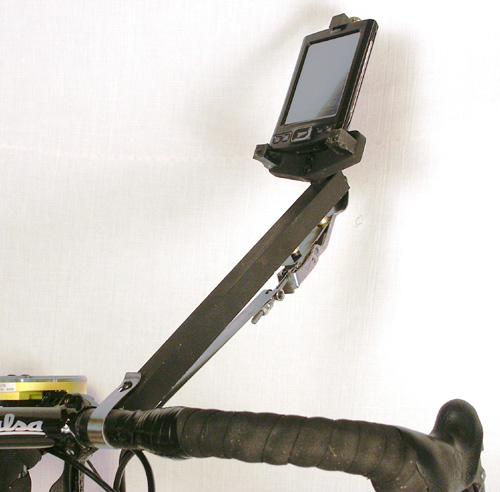"""The holder for the display is forward of the """"drip zone"""".  It attaches well enough that one could pickup the bike with the holder."""