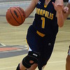 Nurijet Ala and the Annapolis Courgars headed to Dearborn High on Tuesday night. The Cougars ultimately suffered a 69-23 defeat against the Pioneers. (MIPrepZone Photo Gallery by Frank Wladyslawski)