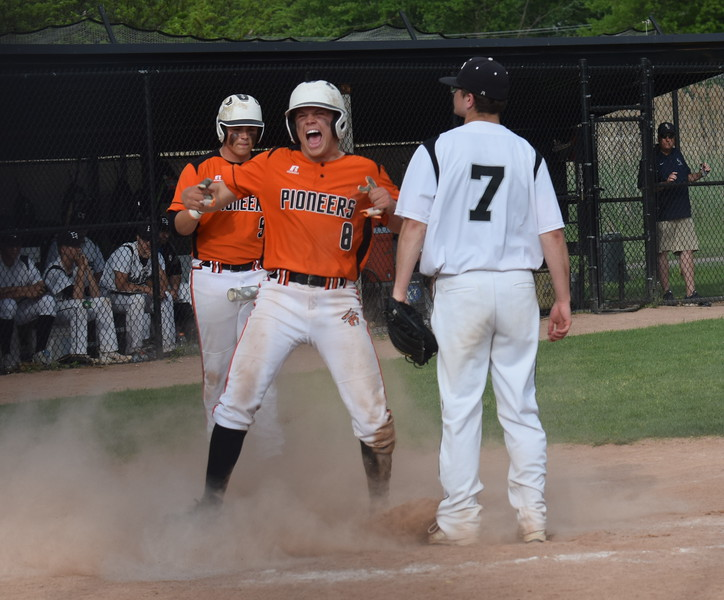 Dearborn High's Ben Clark celebrates after scoring the tying run in the top of the seventh inning at Edsel Ford on Wednesday afternoon. The Pioneers added one more run and ultimately beat the Thunderbirds 5-4. (MIPrepZone Photo Gallery by Frank Wladyslawski)