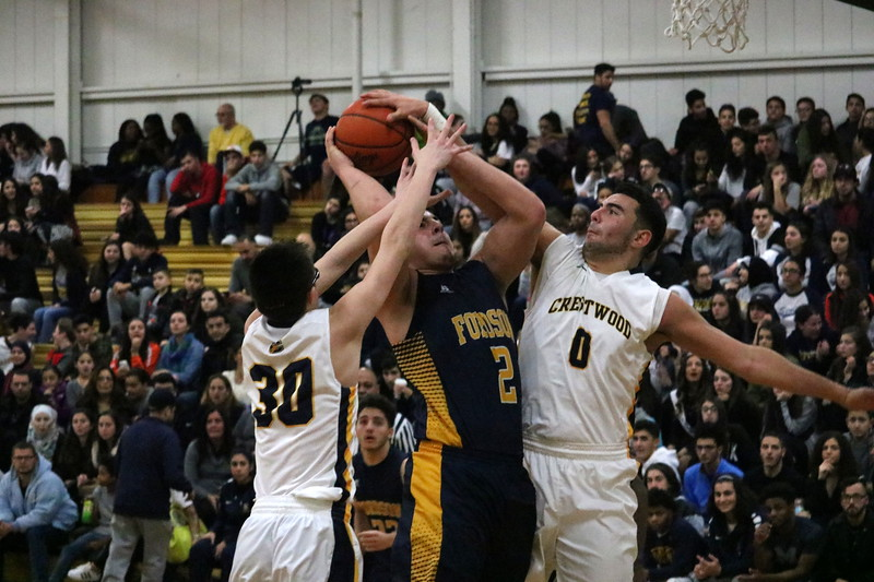 Fordson center Mohamed Amen (2) takes the ball up for a layup, but is contested by Crestwood defenders Jemail Saleh (0) and Jared Weiss (30). Crestwood downed visiting Fordson 58-47 on the strength of a strong fourth quarter on Friday night. (MI Prep Zone photo gallery by RYAN DICKEY)