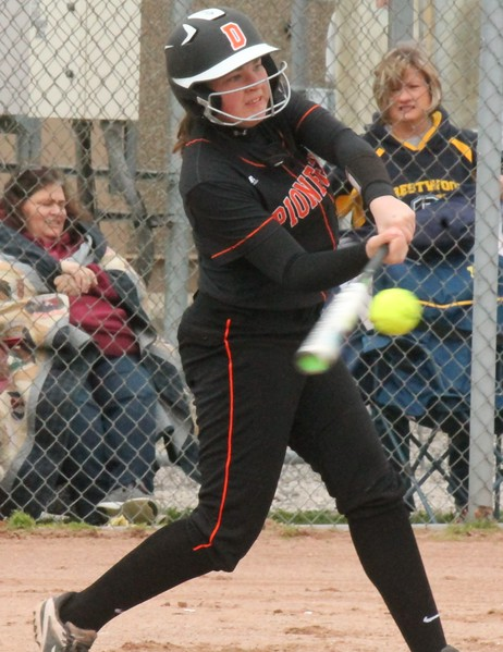 Courtney Turner hits a three-run home run in the first inning for Dearborn High on Friday afternoon at  Crestwood. The Pioneers went on to an 18-1 mercy victory in three innings.  (MiPrepZone photo gallery by Terry Jacoby)