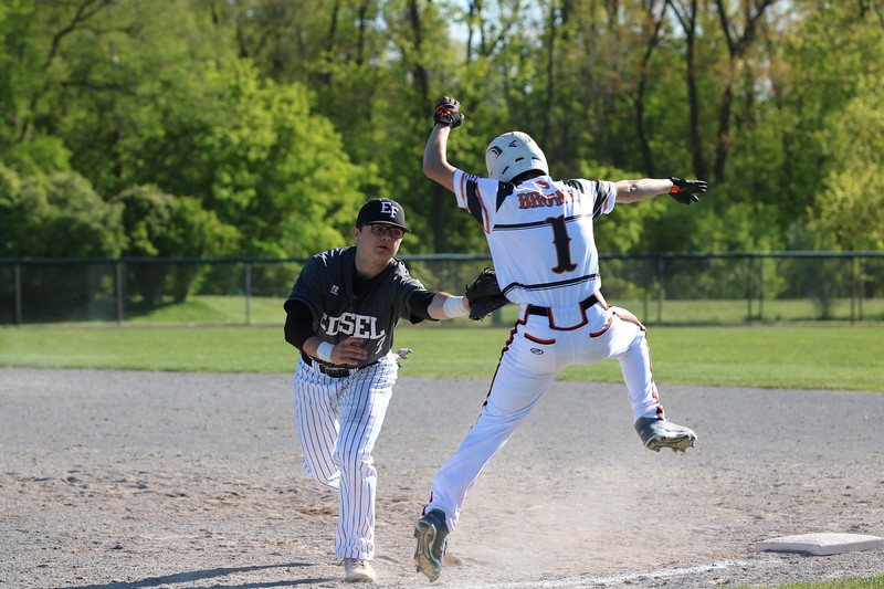 Trevor Blatterline of visiting Edsel Ford applies a tag after a wide throw. Edsel capitalized on six Dearborn High errors on Thursday afternoon to earn a 7-2 victory over its in-city rivals. (Photo gallery for MIPrepZone by Jack VanAssche)