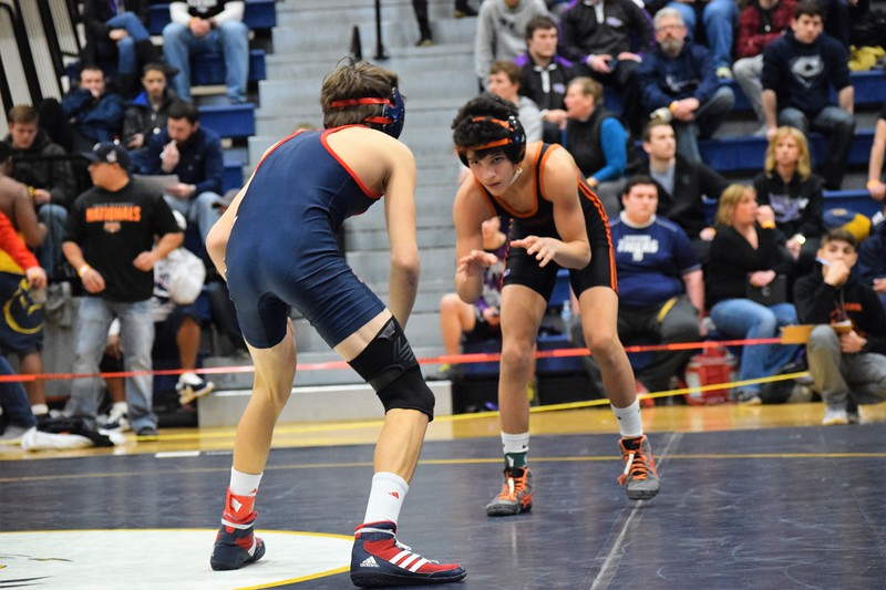 Dearborn High's Aaron Garcia (right) finished runner up at Saline on Saturday in Division 1, Region 3 and earned a spot at the state finals. Overall, a total of five Dearborn-area grapplers punched their tickets to states in Saline.  (MIPrepZone Photo Gallery by Alex Muller)