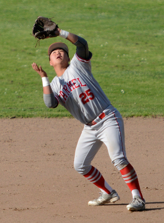 . Carmel\'s Young Jae Chee reels in a fly ball at second base during baseball at Pacific Grove High School on Wednesday April 19, 2017. PG won the game 4-3. (David Royal - Monterey Herald)