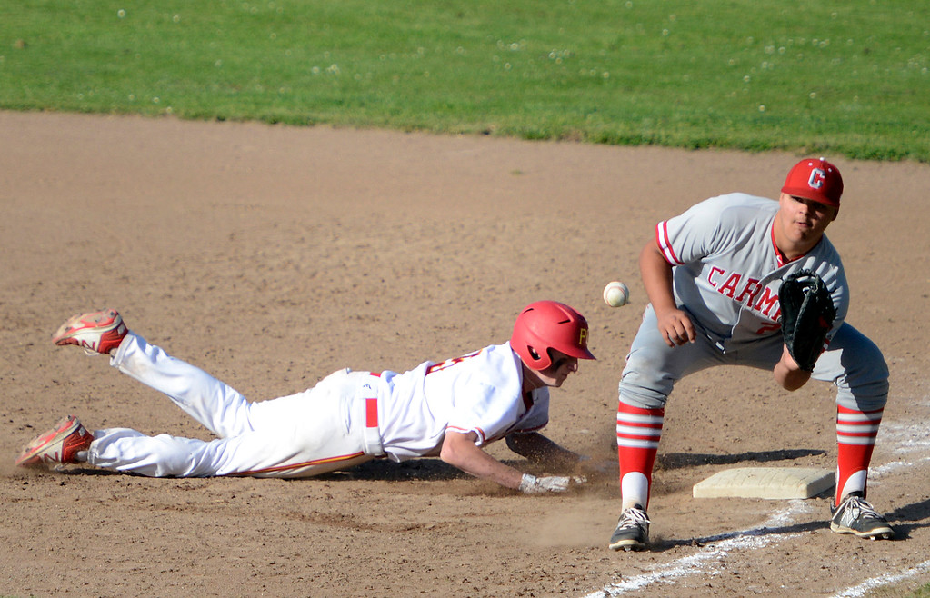 . Pacific Grove\'s Hunter Hanes dives back to first base before the tag by Carmel\'s Christian Stapelton during baseball at Pacific Grove High School on Wednesday April 19, 2017. PG won the game 4-3. (David Royal - Monterey Herald)