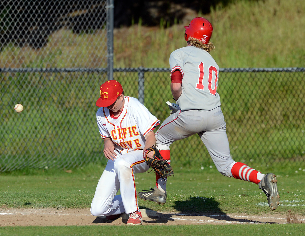 . Carmel\'s Ben Weber collides with Pacific Grove first baseman River Watts during baseball at Pacific Grove High School on Wednesday April 19, 2017. PG won the game 4-3. (David Royal - Monterey Herald)