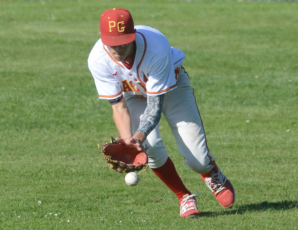 . Pacific Grove right fielder Dylan Graham chases down a grounder during baseball against Carmel at Pacific Grove High School on Wednesday April 19, 2017. PG won the game 4-3. (David Royal - Monterey Herald)