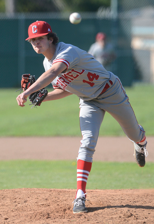 . Carmel\'s Dylan Houpt pitches during baseball at Pacific Grove High School on Wednesday April 19, 2017. PG won the game 4-3. (David Royal - Monterey Herald)