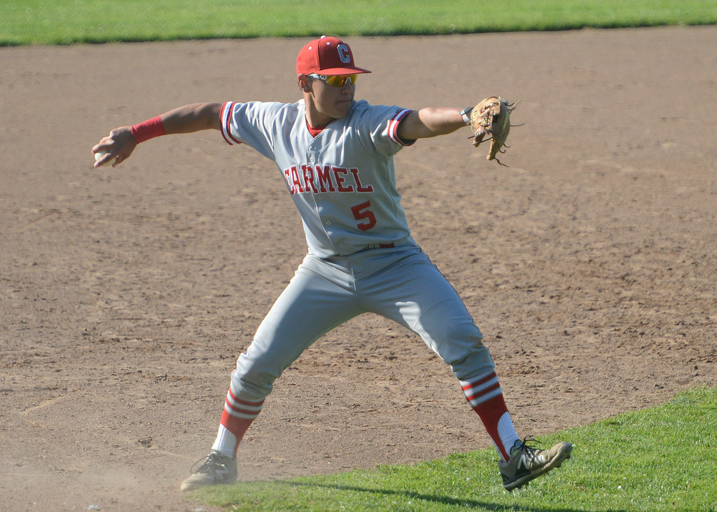 . Carmel\'s Joey Pinto fields a grounder at third base during baseball at Pacific Grove High School on Wednesday April 19, 2017. PG won the game 4-3. (David Royal - Monterey Herald)