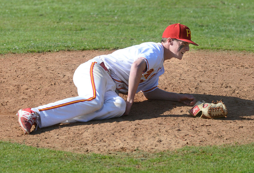 . Pacific Grove\'s Hunter Hanes lays on the ground after getting hit in the knee by a ball while pitching against Carmel during baseball at Pacific Grove High School on Wednesday April 19, 2017. PG won the game 4-3. (David Royal - Monterey Herald)