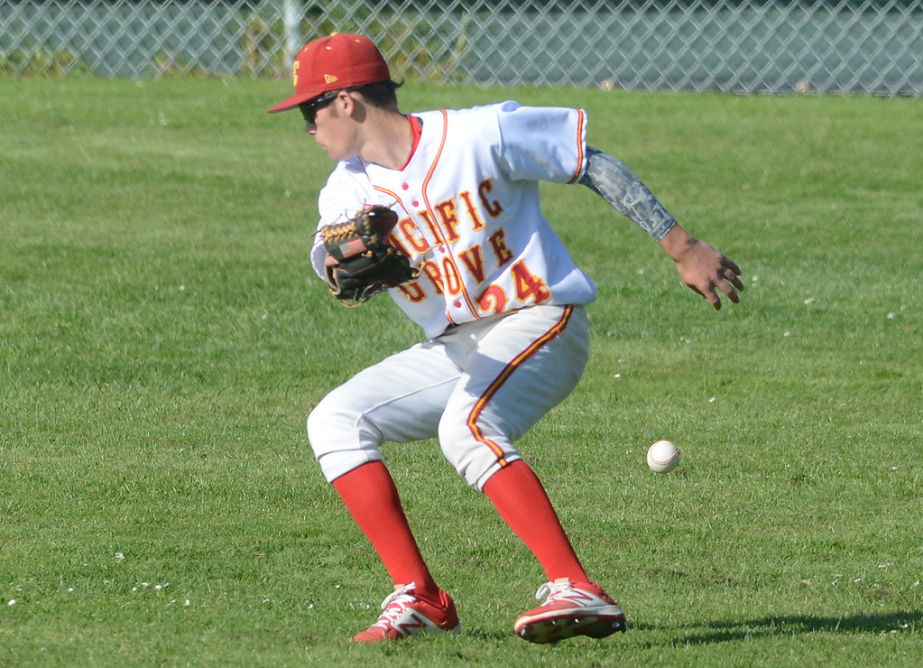 . Pacific Grove right fielder Dylan Graham chases down a grounder that snuck by him during baseball against Carmel at Pacific Grove High School on Wednesday April 19, 2017. PG won the game 4-3. (David Royal - Monterey Herald)