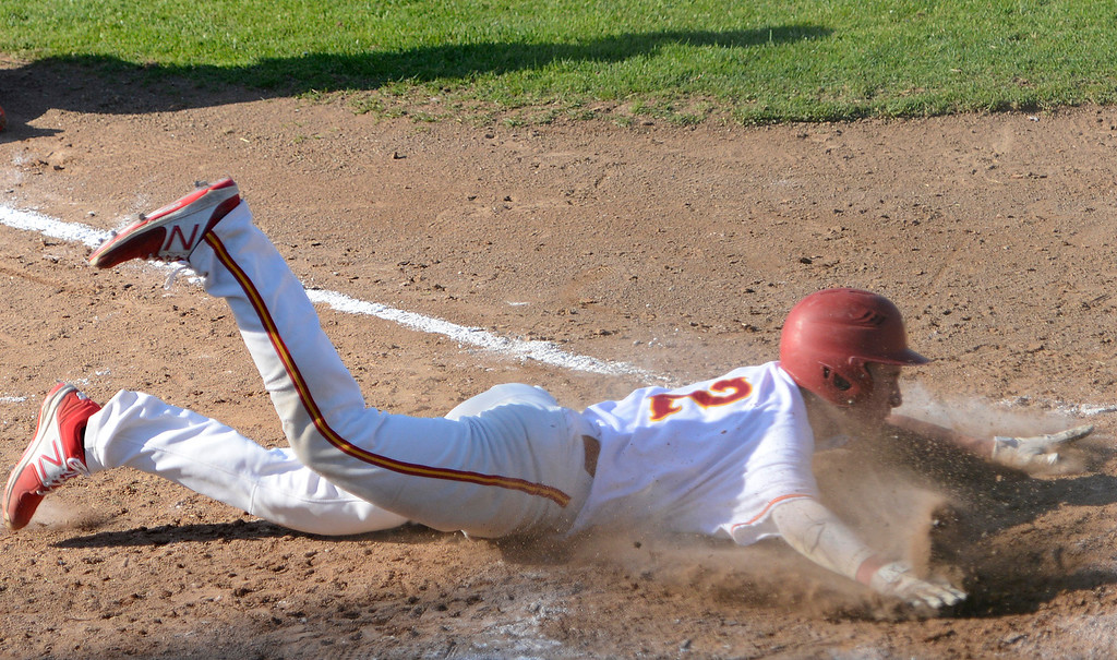 . Pacific Grove\'s Colby Burnell slides safely home past Carmel catcher Daniel Higman  during the fifth inning of baseball at Pacific Grove High School on Wednesday April 19, 2017. PG won the game 4-3. (David Royal - Monterey Herald)