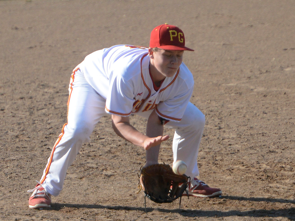 . Pacific Grove\'s Jack Sendel tries to reels in a grounder at third base during baseball at Pacific Grove High School on Wednesday April 19, 2017. PG won the game 4-3. (David Royal - Monterey Herald)