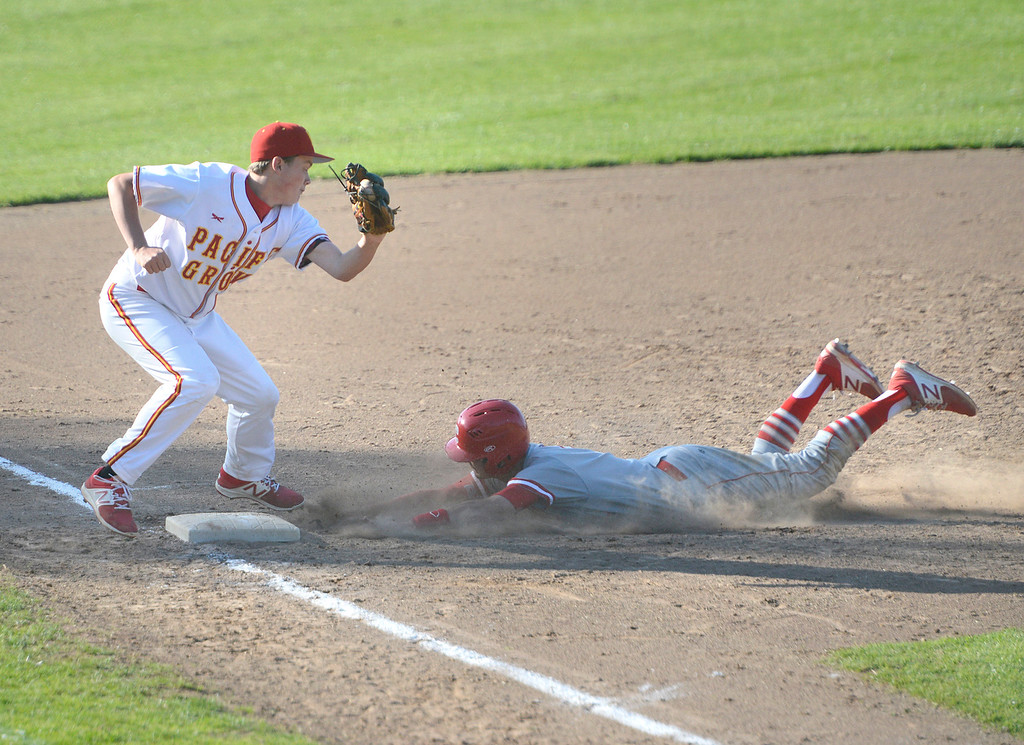 . Carmel\'s Daniel Higman slides safely to third base under the tag by Pacific Grove\'s Jack Sendel during baseball at Pacific Grove High School on Wednesday April 19, 2017. PG won the game 4-3. (David Royal - Monterey Herald)