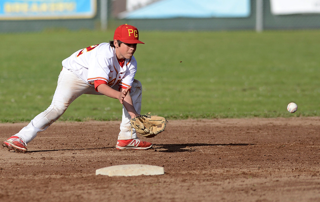 . Pacific Grove\'s Charlie McMahon reels in a grounder at second base during baseball against Monte Vista Christian in Pacific Grove on Wednesday April 12, 2017. (David Royal - Monterey Herald)