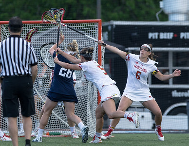The top-seeded and top-ranked Maryland Terps' defense shuts down Penn State's Maria Auth in a lopsided 15-8 Big10 semi-final win on May 3. PHOTO BY MIKE CLARK