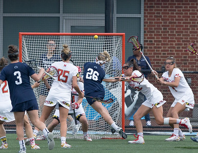 Penn State's Maria Auth (26) elludes the Maryland defenders but is stopped by the Terps' red-hot goalie Megan Taylor. Taylor finished with 14 saves at a rate of 66.7 percent in the semi-finals 15-8 win. PHOTO BY MIKE CLARK
