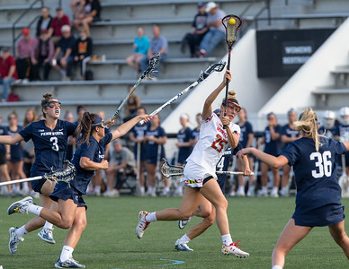 Lizzie Colson of Maryland splits Penn State defenders for her score in the Big10 semi-finals. PHOTO BY MIKE CLARK
