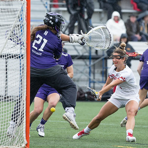 Maryland Attacker Brindi Griffin sneaks a score through the legs of Northwestern Goalie Mallory Weisse. PHOTO BY MIKE CLARK