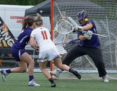 Northwesterns Goalie Mallory Weisse uses her head to stop this shot attempt by Maryland's Caroline Steele. Weisse recorded 10 saves on the afternoon. PHOTO BY MIKE CLARK