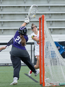 Northwestern Goalie Mallory Weisse stops the point blank range shot attempt of Grace Griffin. PHOTO BY MIKE CLARK