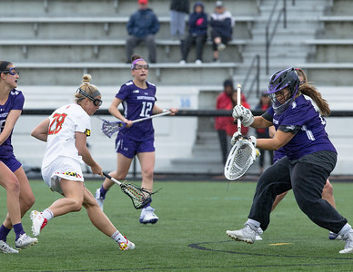 Northwestern Goalie Mallory Weisse stops the shot attempt of Hannah Warther, records 10 saves, and is crowned the Big10 Tournament MVP. PHOTO BY MIKE CLARK