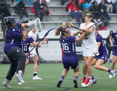 Despite the pressure from Northwestern's Kate Copeland, Maryland's Grace Griffin scores late in the championship game. PHOTO BY MIKE CLARK