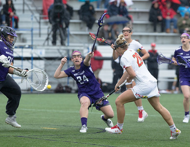 Maryland's Hannah Warther gets one of her two scores against Northwestern Goalie Mallory Weisse in the Big10 championship. PHOTO BY MIKE CLARK